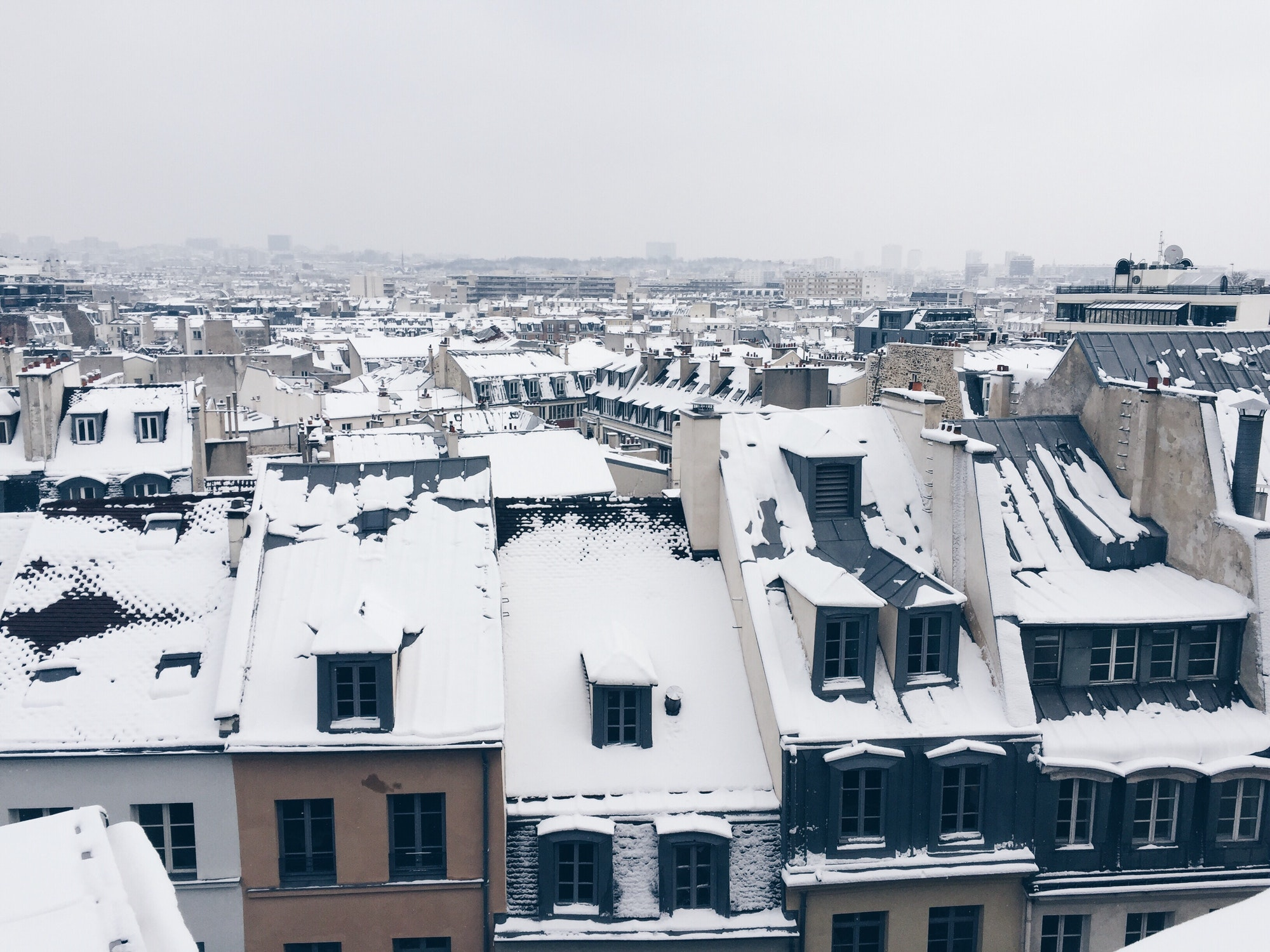 Snow in Paris, rooftop view and shades of grey, horizon over the city, roofs, cityscape, city view